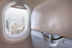 View on modern city from airplane window Stock Photos
