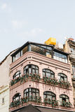 View of modern city building facade with floral balconies. Stock Photography