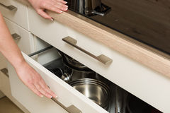View on modern cooker with open drawer under the stove Royalty Free Stock Photography