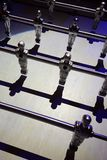 A view from a modern foosball, or bar foot, or table foot, with shining players Royalty Free Stock Photography