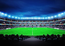 View on modern football stadium with fans in the stands Stock Images