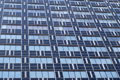 View of modern glass and metal blue building. With many windows Royalty Free Stock Image
