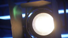 View of modern lighting equipment in a film studio, lamp is switching on and illuminating brightly. Panorama stock video footage