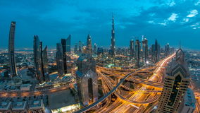 View on modern skyscrapers and busy evening highways day to night timelapse in luxury Dubai city, Dubai, United Arab stock footage