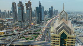 View on modern skyscrapers and busy evening highways day to night timelapse in luxury Dubai city, Dubai, United Arab stock video footage