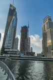 Dubai Marina. View at modern skyscrapers in Dubai Marina in Dubai, UAE. When the entire development is complete, it will accommodate more than 120,000 people Royalty Free Stock Photo