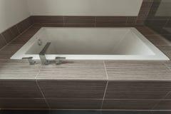 View of modern sleek bathtub Royalty Free Stock Photos