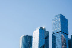 View of modern tall skyscrapers in business center of Moscow city against blue sky background, contemporary office buildings in ri Stock Photo