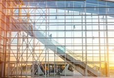 Facade with escalator at the airport. View on the modern transparent facade with escalator at the airport Royalty Free Stock Photos