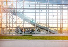 Facade with escalator at the airport. View on the modern transparent facade with escalator at the airport Stock Photos