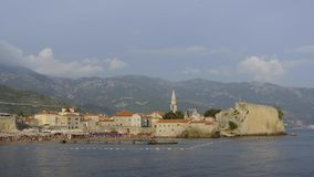 View on Mogren beach and old town, Budva, Montenegro, timelapse stock video