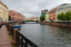 View of Moika river embankment on a rainy summer day. RUSSIA, SAINT PETERSBURG - AUGUST 18, 2017:  View of Moika river embankment on a rainy summer day Stock Image