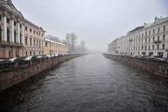 View of the Moika river with the Nevsky Prospekt in rainy cloudy. Day in Saint-Petersburg, Russia Royalty Free Stock Photos