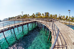 View of Molos Promenade from the wooden pier on the coast of Lim Royalty Free Stock Photography