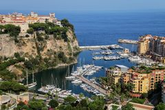 View of Monaco City and Fontvieille with boat marina in Monaco. Monaco City and Fontvieille are two of the four traditional quarters of Monaco Royalty Free Stock Photos