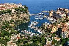 View of Monaco City and Fontvieille with boat marina in Monaco. Monaco City and Fontvieille are two of the four traditional quarters of Monaco Royalty Free Stock Photography