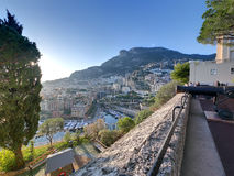 View of monaco fontvieille. View of city of monaco district fontvieille with the harbor harbour mountain hill and sunset hdr Stock Images
