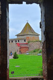 View of Monarchic tower from ruined temple in Fortress Oreshek near Shlisselburg, Russia Stock Photo