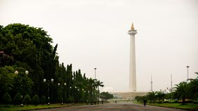The view of Monas, Jakarta, Indonesia. JAKARTA, INDONESIA - MARCH 5, 2016: The view of Monas. A historical landmark placed in Central Jakarta, Indonesia stock images