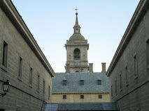 View of the Monastery of El Escorial. View of the Monasterio de El Escorial, from one of the nearby streets. Spain Royalty Free Stock Image