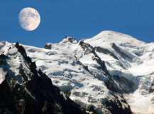 View of mont blanc in the alps. Mountain Mont Blanc with the full moon in the month Royalty Free Stock Photos