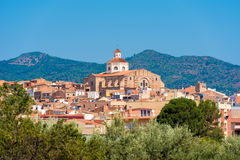 View of Mont-roig del Camp and the church of St. Miguel, Tarragona, Catalunya, Spain. Copy space for text. Stock Photos