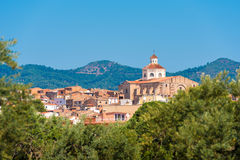 View of Mont-roig del Camp and the church of St. Miguel, Tarragona, Catalunya, Spain. Copy space for text. Royalty Free Stock Photo