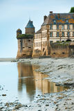 View of Mont Saint Michel abbey. Partial view of Mont Saint Michel abbey with tower and wall Royalty Free Stock Photos