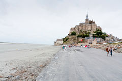 View on Mont Saint-Michel, France. MONT SAINT-MICHEL, FRANCE - JULY 5: Mont Saint-Michel. Mont-Saint-Michel was used in 6-7th centuries as Armorican stronghold Stock Photo