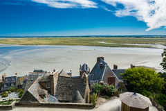 View from the Mont-Saint-Michel, France. Saint Michael`s Mount is an island commune in Normandy. The island has held strategic fortifications since ancient times Royalty Free Stock Images