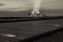 View on Mont Saint Michel with walking path, sepia toned, Normandy Royalty Free Stock Photography