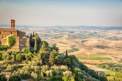 View of Montalcino, countryside landscape in the background, Tuscany Italy Stock Photos