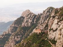 View from Montserrat monastery - mountains and Santa Cova Chapel Stock Photos