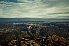 A view from the Montserrat mountain top. Beautiful panorama of valley, sky and misty mountains on a background Royalty Free Stock Photography