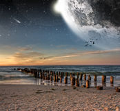 View of the moon from a beautiful beach Stock Images