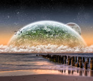 View of the moon from a beautiful beach Royalty Free Stock Photography