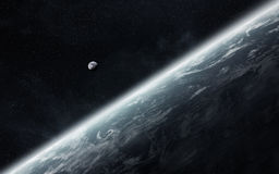 View of the moon close to planet Earth in space Royalty Free Stock Images