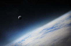 View of the moon close to planet Earth in space Royalty Free Stock Photo