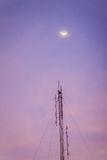 View of the moon on the dusk sky and the folded dipole radio ant Royalty Free Stock Photos