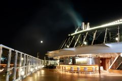 View of the moon at night from the cruise ship deck.  Stock Photography