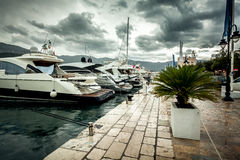 View of moored luxurious yachts at cloudy and rainy day Stock Images