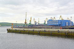View of the mooring and port cranes of Murmansk Commercial Seaport Stock Photography