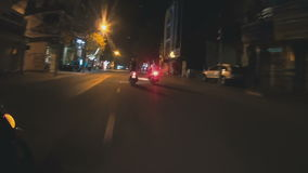 View from moped to the street. View from moped to night street stock footage