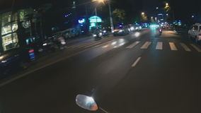 View from moped to the street. View from moped to night street stock video