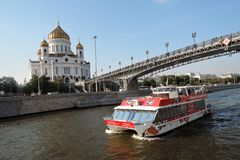 View of Moscow city center and its famous landmarks. Christ the Redeemer cathedral, Patriarshy bridge. Cruise ships sail on the Moscow river. Sunny day Stock Image