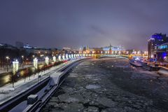 View of Moscow Kremlin and Bolshoy Kamenny Bridge from Patriarshy Bridge at night in winter. Moscow. Russia. View of Moscow Kremlin and Bolshoy Kamenny Bridge royalty free stock image