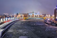 View of Moscow Kremlin and Bolshoy Kamenny Bridge from Patriarshy Bridge at night in winter. Moscow. Russia. View of Moscow Kremlin and Bolshoy Kamenny Bridge stock photo