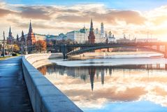 View of the Moscow Kremlin with its towers and cathedrals. And reflections in the Moscow River early sunny golden morning Stock Images