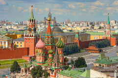 View on Moscow Red Square, Kremlin towers, Clock Kuranti, Saint Basil`s Cathedral church, Lenin mausoleum. Panorama Hotel Russia. Royalty Free Stock Photos