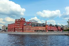 View from the Moscow River on buildings of Red October chocolate factory on embankment royalty free stock image